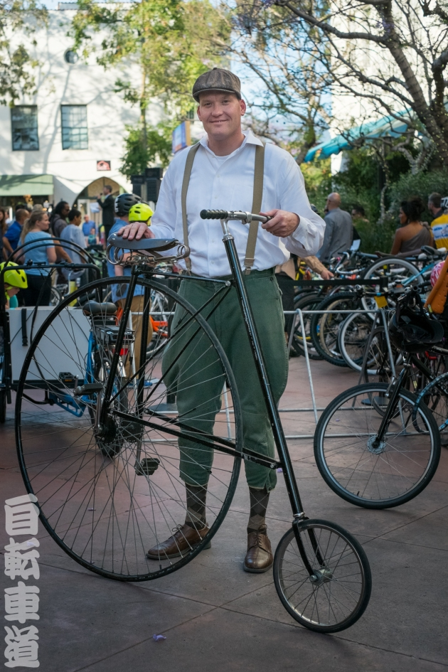 CycleMAYnia 2014. Giant dude with reverse pennyfarthing.